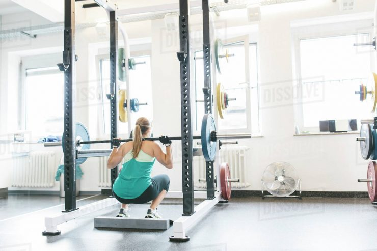Barbell Squat met een power rack