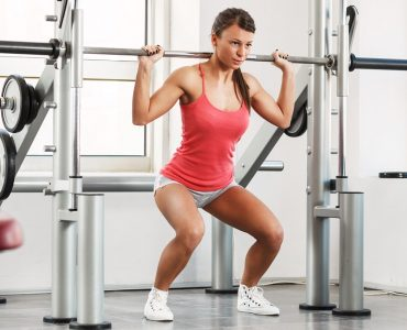 Smith squat met een smith machine