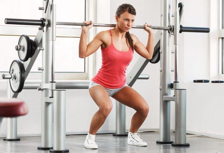 Smith squat met een smith machine